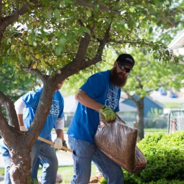 Outside the new Community Services League location, Comcast Cares Day volunteers laid mulch, pruned trees and did some landscaping and general cleanup.